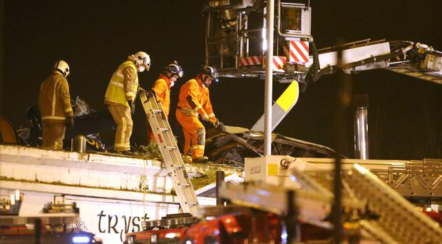 Ten people died after a police helicopter crashed through the roof of the Clutha pub in Glasgow (Andrew Milligan/PA)