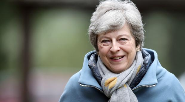 Theresa May has defended her decision to hold cross-party talks with Labour (Andrew Matthews/PA)