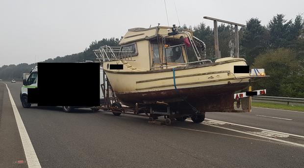 The stranded boat caused the closure of a slip road, Highways England said (Highways England/PA)