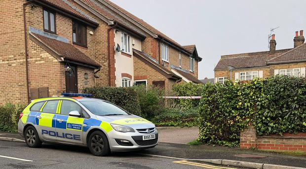Police at the scene in Westminster Gardens, Chingford (PA)