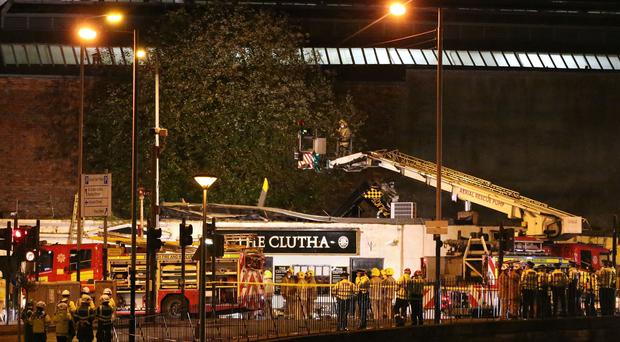 Police and Scottish Fire and Rescue services at the scene of a helicopter crash at the Clutha Bar in Glasgow in 2013 (Andrew Milligan/PA)