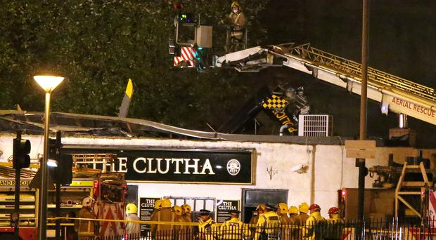 Police and Scottish Fire and Rescue services at the scene of the helicopter crash at the Clutha Bar in Glasgow in 2013 (Andrew Milligan/PA)