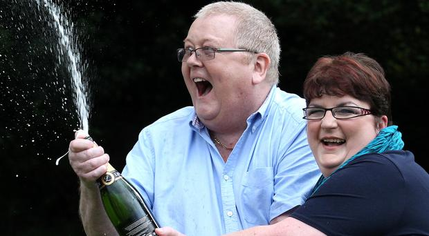 Colin and Chris Weir celebrate during a photo call after they scooped £161m (Andrew Milligan/PA)