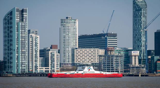The Red Kestrel passes Liverpool's waterfront as it travels along the Mersey (Cammell Laird/PA)