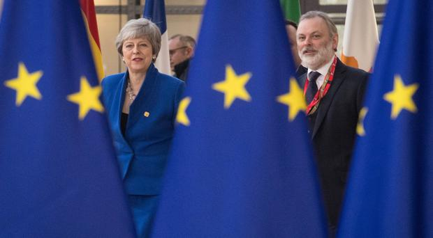 Prime Minister Theresa May and Sir Tim Barrow, the UK's Permanent Representative to the EU, arrive at the European Council in Brussels where European Union leaders are meeting to discuss Brexit. (Stefan Rousseau/PA)