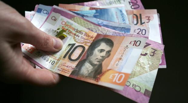 The proposed law would give legal force to Scottish banknotes being acceptable across the UK (Jane Barlow/PA)