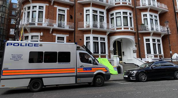 A police van outside the Ecuadorian Embassy in London, after WikiLeaks founder Julian Assange was arrested by officers from the Metropolitan Police and taken into custody following the Ecuadorian government's withdrawal of asylum (Rebecca Brown/PA)