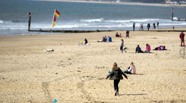 Families on the beach in Bournemouth, Dorset (Steve Parsons/PA)