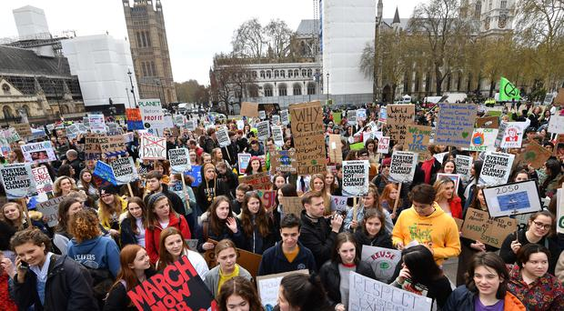 Students take part in a protest for the climate crisis outside Parliament Square (John Stillwell/PA)