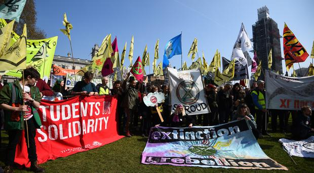 Demonstrators during a Extinction Rebellion protest in Parliament Square, London (/PA)