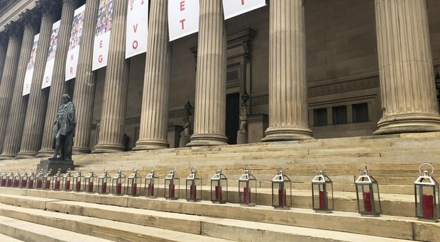 Ninety-six lanterns are lit on the steps of St George's Hall in Liverpool to mark the 30th anniversary of the Hillsborough disaster (Eleanor Barlow/PA)