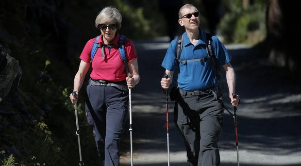 Theresa May and her husband Philip during a 2016 walking holiday in Switzerland (Marco Bertorello/PA)
