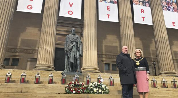 Mayor of Liverpool Joe Anderson and Lord Mayor Christine Banks stand on the steps of St George's Hall in Liverpool after laying wreaths (Eleanor Barlow/PA)