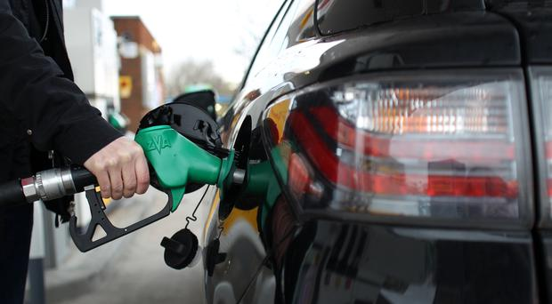 Drivers faced higher fuel costs in March, but inflation remained flat due to lower food prices (Lynne Cameron/PA)