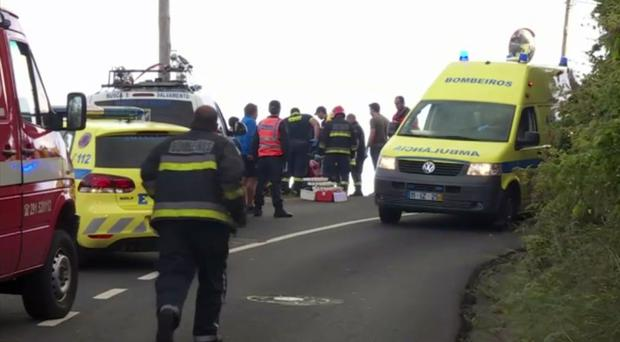 In this image from video, emergency services attend to the injured (TVI via AP)