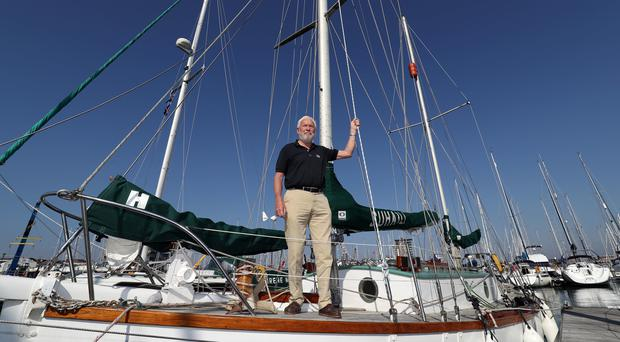 Sir Robin Knox-Johnston stands on the deck of his boat Suhaili (Andrew Matthews/PA)