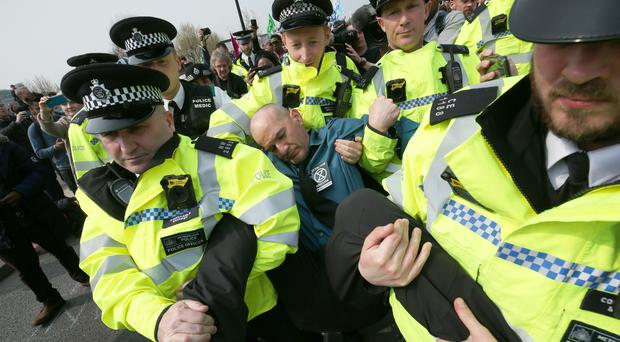 Police officers begin to remove Extinction Rebellion demonstrators on Waterloo Bridge (London Jonathan Brady/PA)