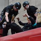 Police remove climate activists who glued themselves to a DLR train at Canary Wharf