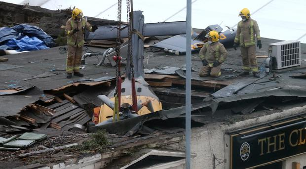 The helicopter was returning to its base when it crashed through the roof of the pub (PA)
