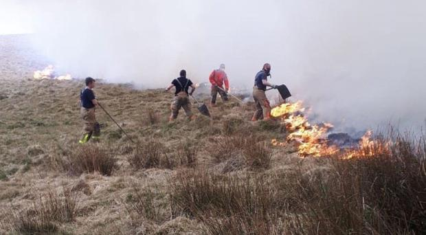 Firefighters work to put out a blaze in Lyme Park, near Manchester (Cheshire Fire and Rescue Service/PA)