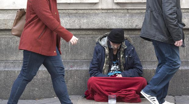 A homeless person outside Victoria Station in London, (Victoria Jones/PA)