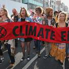 Extinction Rebellion demonstrators at Oxford Circus, London. Londoners face a fourth day of disruption in the capital, despite nearly 400 arrests.