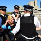 Metropolitan Police carry away an Extinction Rebellion demonstrator (Victoria Jones/PA)
