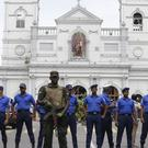 Sri Lankan Army soldiers secure the area around St Anthony's Shrine (Eranga Jayawardena/AP)