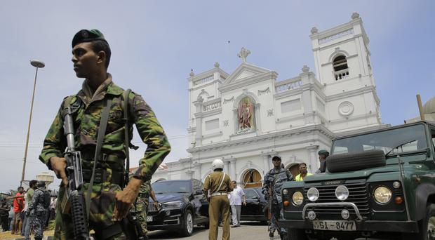 Soldiers secure the area around St Anthony's Shrine after a blast in Colombo (Eranga Jayawardena/AP)