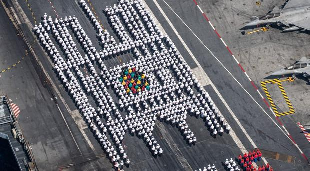 French sailors have paid tribute to the Notre Dame cathedral by lining up in the shape of the landmark. (Marine Nationale/PA)