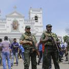 Sri Lankan Army soldiers secure the area around St Anthony's Shrine after a blast in Colombo (Eranga Jayawardena/AP)