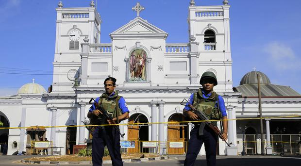 Soldiers stand guard in front of St Anthony's Shrine in Colombo (Eranga Jayawardena/AP)