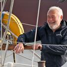 Sir Robin Knox-Johnson on board his boat (Andrew Matthews/PA)