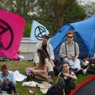People enjoy the warm weather in the Extinction Rebellion (XR) camp (Kirsty O'Connor/PA)