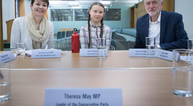 There was an empty place at the table for Theresa May as Swedish climate activist Greta Thunberg met UK politicians including Caroline Lucas and Jeremy Corbyn (Stefan Rousseau/PA)