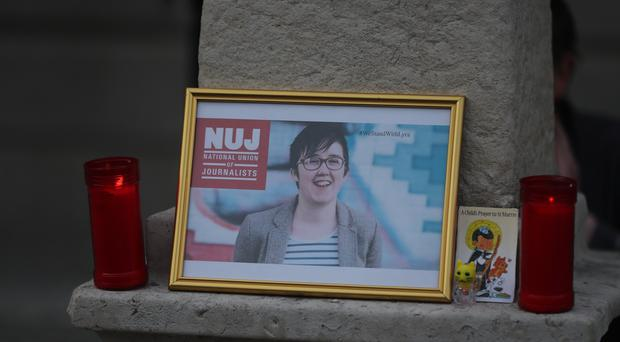A image of 29 year-old Lyra McKee displayed during a vigil in Dublin for the murdered journalist.