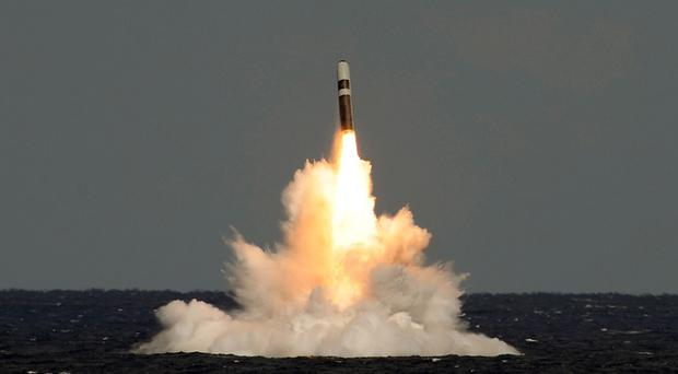 Undated handout photo issued by the Ministry of Defence of missile firing from HMS Vigilant, which fired an unarmed Trident missile (Lockheed Martin/MoD/PA)