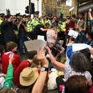 Extinction Rebellion protesters in Westminster hold up letters they have written to their MPs asking for action on climate issues (Kirsty O'Connor/PA)