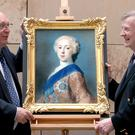 Curator David Forsyth, left, and owner Peter Pininiski unveil the rediscovered portrait of Bonnie Prince Charlie (Jane Barlow/PA)