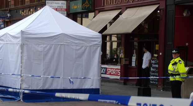 The crime scene outside McColl's newsagents in St Enoch Square, Glasgow. A 38-year-old shop worker was stabbed to death in the shop.