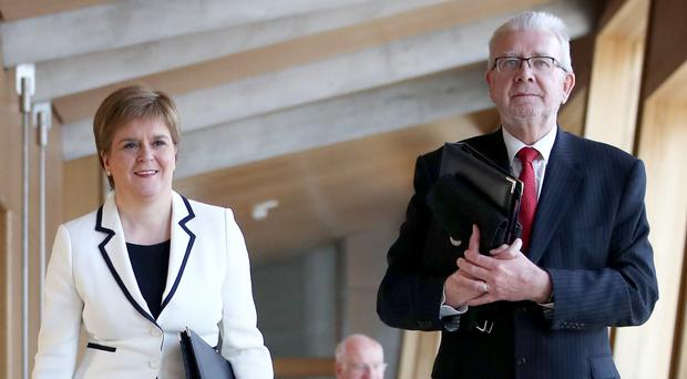 First Minister Nicola Sturgeon arrives with Scottish Brexit Minister Mike Russell ahead of delivering her statement on Brexit and Scottish Independence in the main chamber of the Scottish Parliament, Edinburgh.