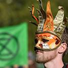 Extinction Rebellion protesters In Hyde Park in London (Dominic Lipinski/PA)