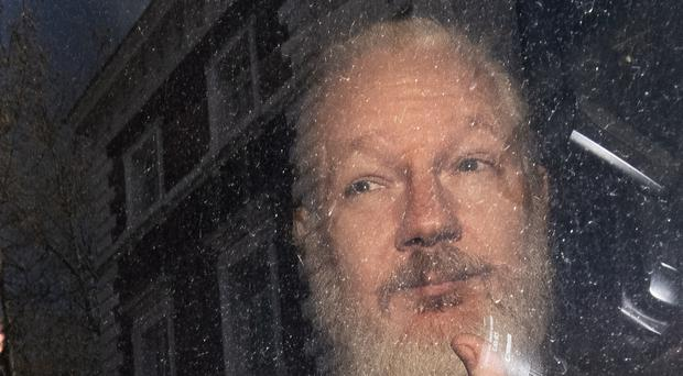 Julian Assange is in prison after being taken out of the Ecuadorian embassy (Victoria Jones/PA)