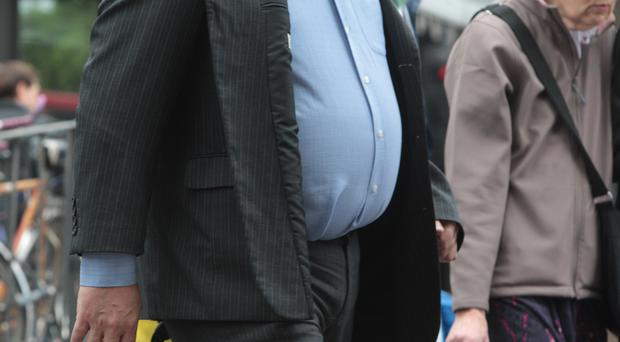 Walking to work could cut the risk of an early death among obese people (Andrew Gray/ PA)
