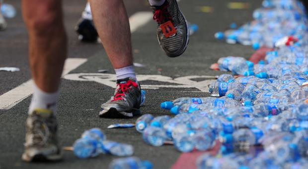 Empty bottles of water line the streets during the 32nd Virgin London Marathon in London (PA)