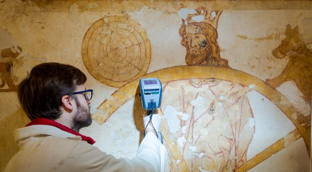 Extremely rare wall paintings are undergoing conservation using hi-tech equipment (English Heritage/PA)