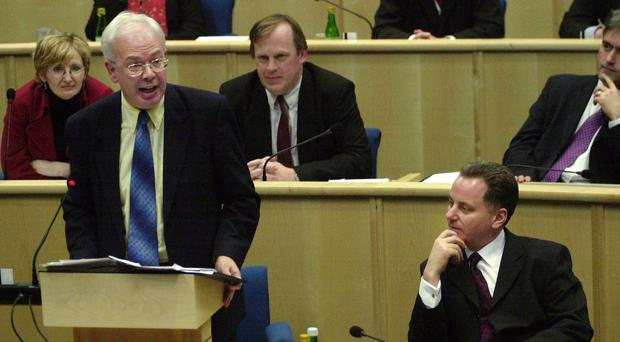 Jim Wallace, in his time as Acting First Minister with his successor Jack McConnell (R) in the Scottish Parliament (PA)