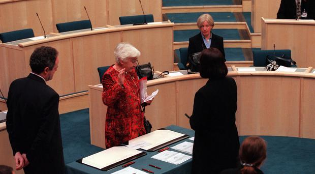 Winnie Ewing, the oldest member of the Scottish Parliament, swears in on the first day of the Scottish Parliament (Ben Curtis/PA)
