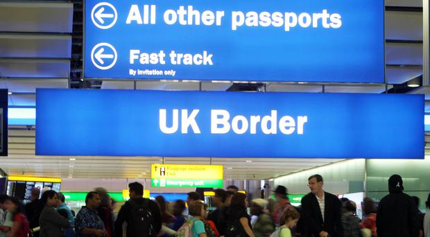 The poll suggests that nearly half of people in Scotland think that too many people are coming to the UK (Steve Parsons/PA)