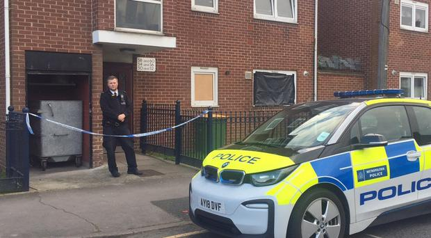 Police at a property where two women were found dead (Tom Pilgrim/PA)